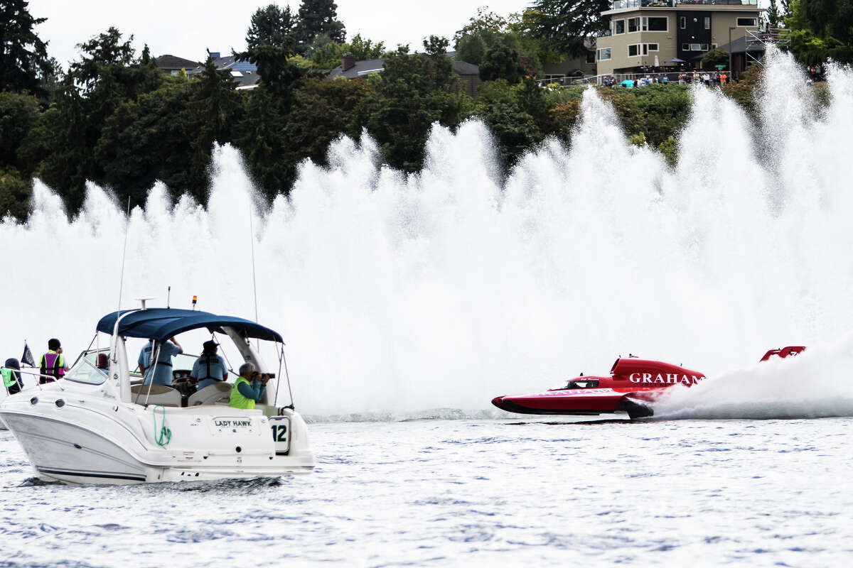 The Graham Trucking hydroplane passes by a press boat during a qualifying heat on day three of Seafair, Sunday, Aug. 7, 2016. (Lacey Young, seattlepi.com)