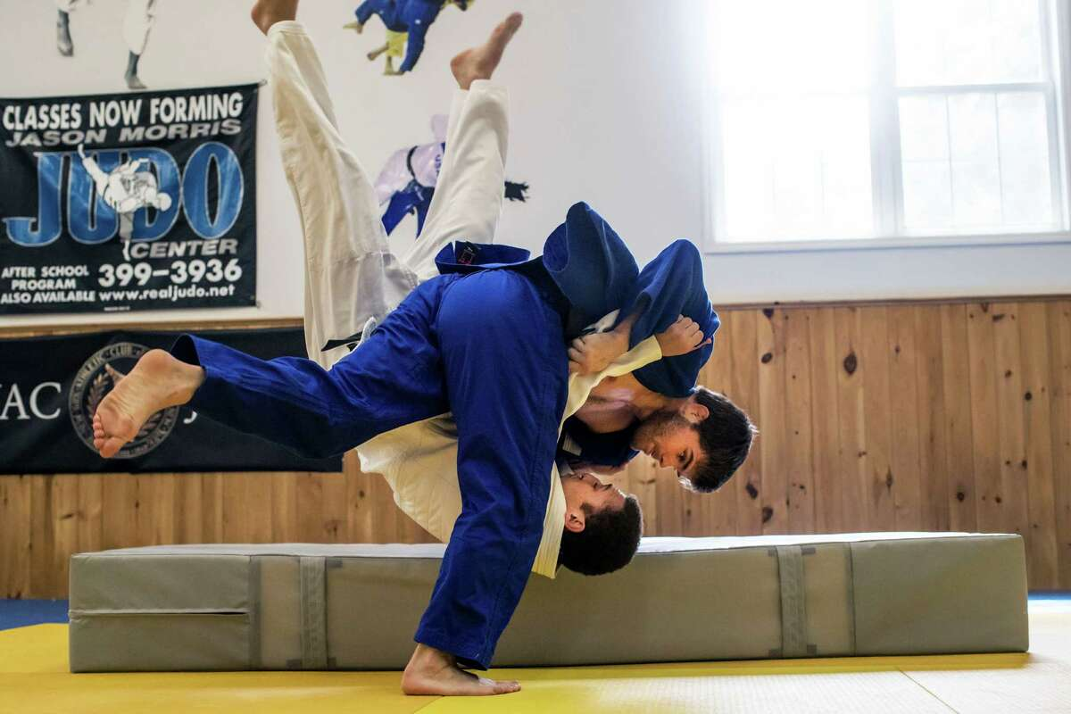 Nick Delpopolo, in the dark outfit, spars with Kyle Wright at the Jason Morris Judo Center in Glenville, N.Y., July 25, 2016. Delpopolo, an orphan born in Montenegro, is believed to be the only foreign-born adoptee on the U.S. team at this Olympics. (There are other foreign-born adoptees on the Paralympic team.) (Nathaniel Brooks/The New York Times) ORG XMIT: XNYT32