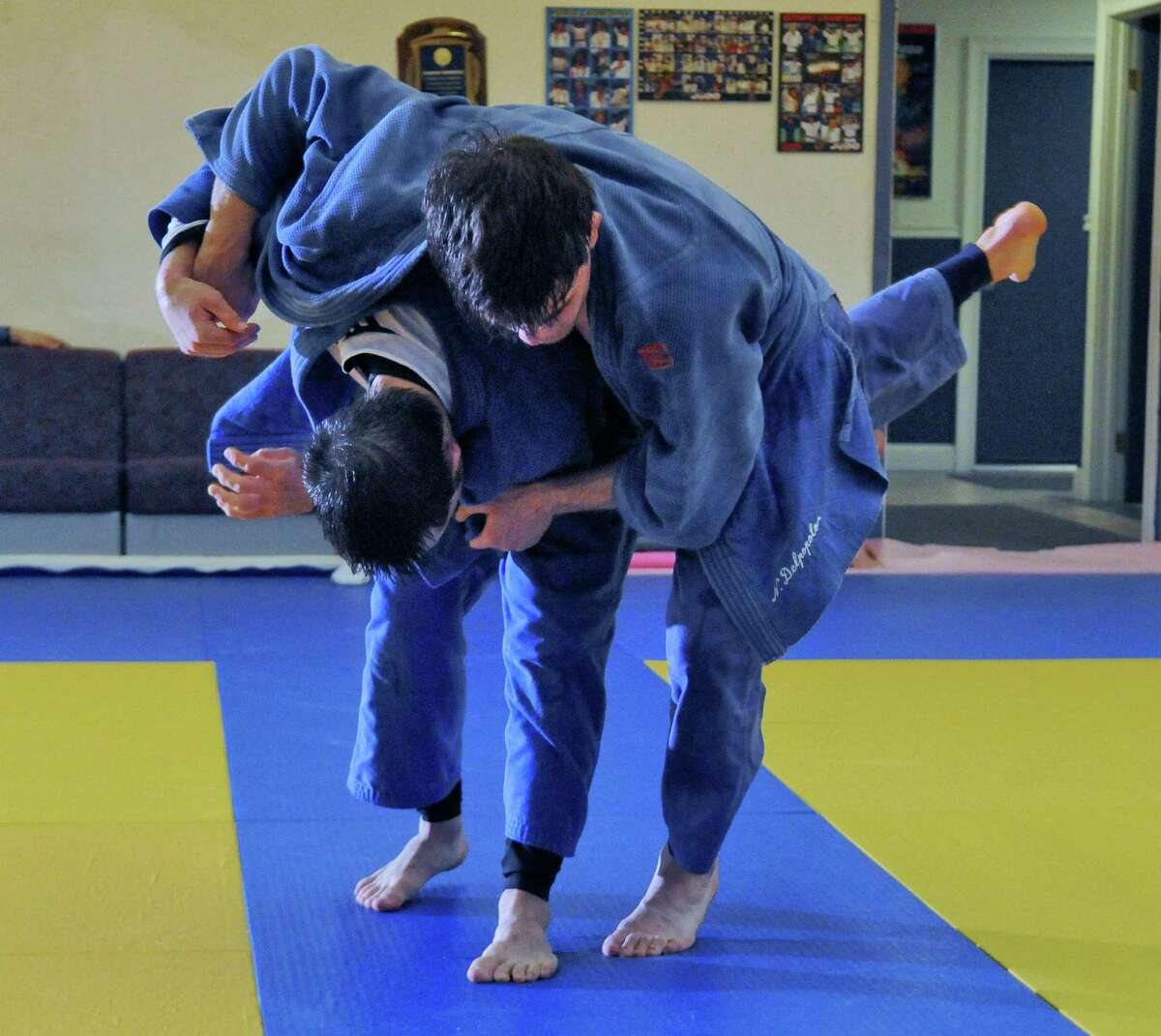 Burnt Hills graduate Nick Delpopolo, right hopes to make the U.S. Olympic team in judo, and has to win a bout on Saturday to qualify. He and Nick Kossor, left, work on tachiwaza, or standing technique, at the Jason Morris Judo Center on Monday night May 7, 2012 in Glenville, NY.(Philip Kamrass / Times Union )