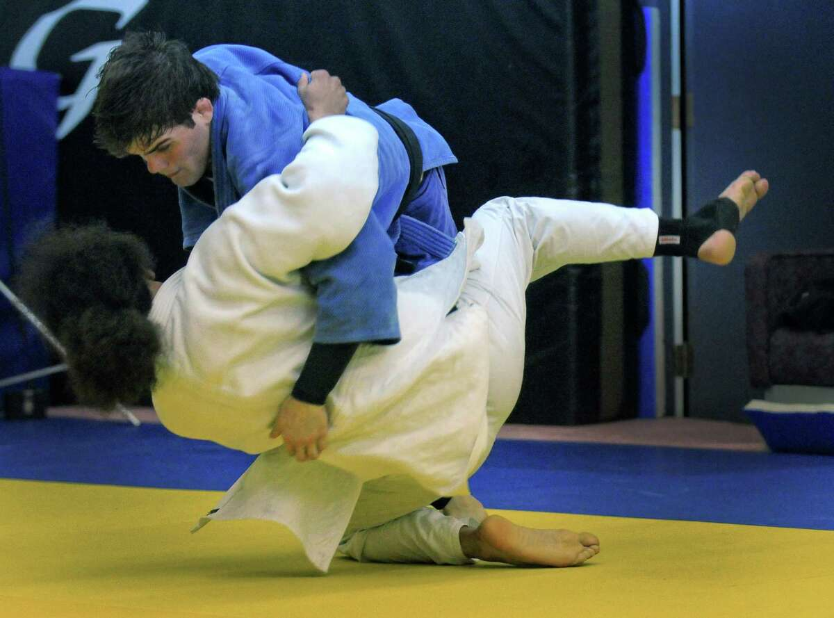 Burnt Hills graduate Nick Delpopolo, right, hopes to make the U.S. Olympic team in judo, and has to win a bout on Saturday to qualify. He throws Alex Turner while doing tachiwaza, or standing technique, at the Jason Morris Judo Center on Monday night May 7, 2012 in Glenville, NY.(Philip Kamrass / Times Union )