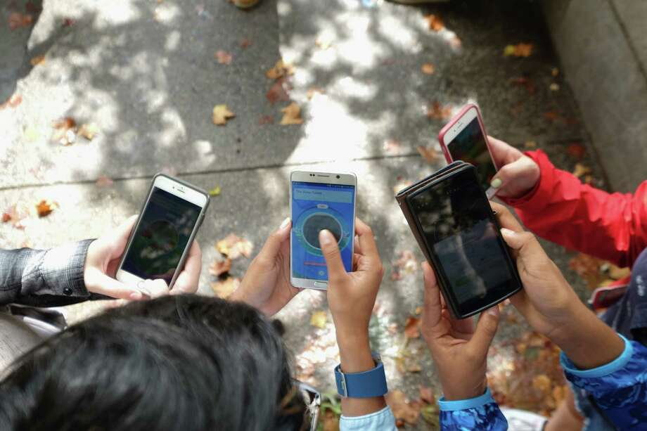 This file photo shows children playing Pokémon Go in Central Park as Pokémon Go craze hit New York City last month. Parents should be sure their children play the game safely. Photo: Michael Loccisano /Getty Images / 2016 Getty Images