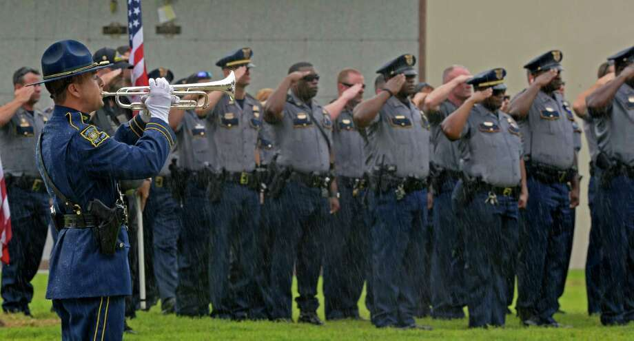 Baton Rouge officers honor police Cpl. Montrell Jackson, who was slain by a gunman last month. A reader comments on proposed federal legislation regarding the murders of police officers. Photo: Hilary Scheinuk /Associated Press / The Advocate