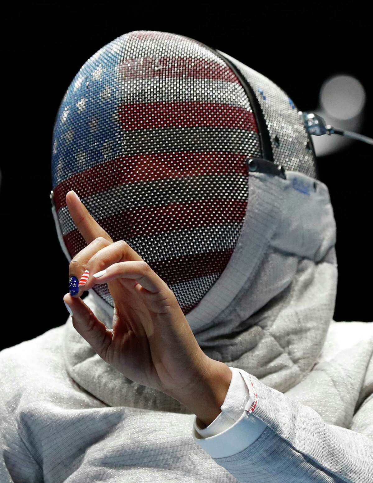 Ubrihaj Muhammad from United States, prepare for match against Olena Kravatska from Ukraine, competes in the women's saber individual fencing event at the 2016 Summer Olympics in Rio de Janeiro, Brazil, Monday, Aug. 8, 2016.