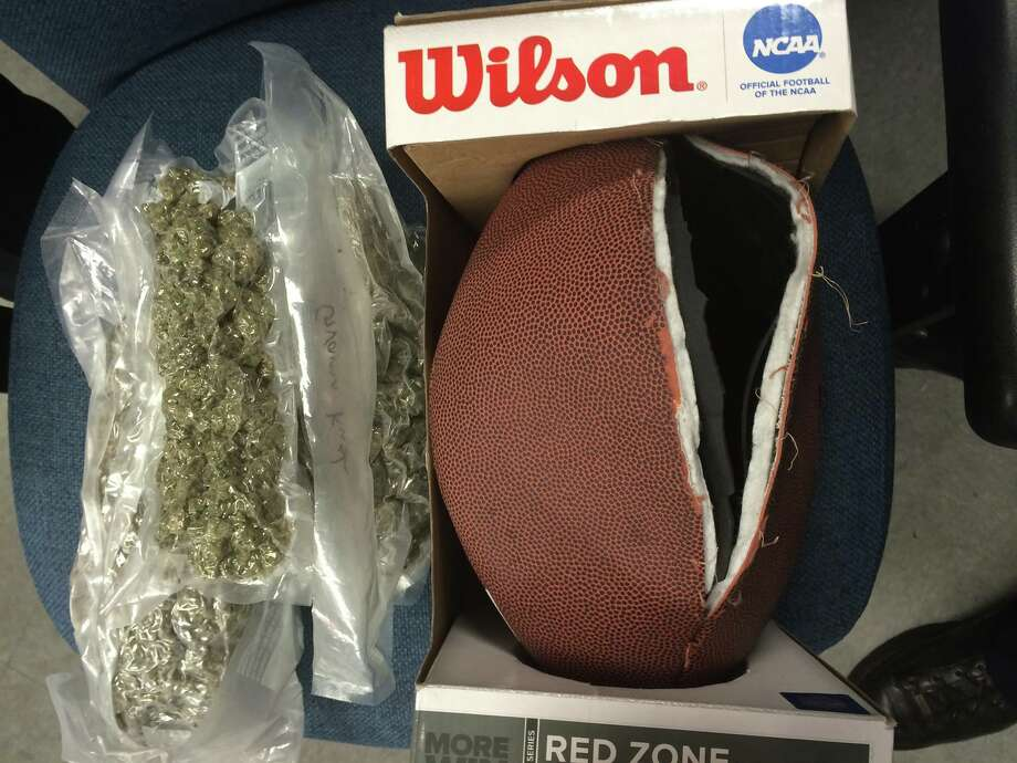 Beaverton Police confiscated 4.5 pounds of marijuana, 16.5 pound of marijuana laced edibles, 108 packages of marijuana laced Kool-Aid mix, over 3.5 ounces of heroin, an ounce of meth and an ounce of cocaine, some of which was inside of footballs that had been re-stitched. Photo: Beaverton Police Department