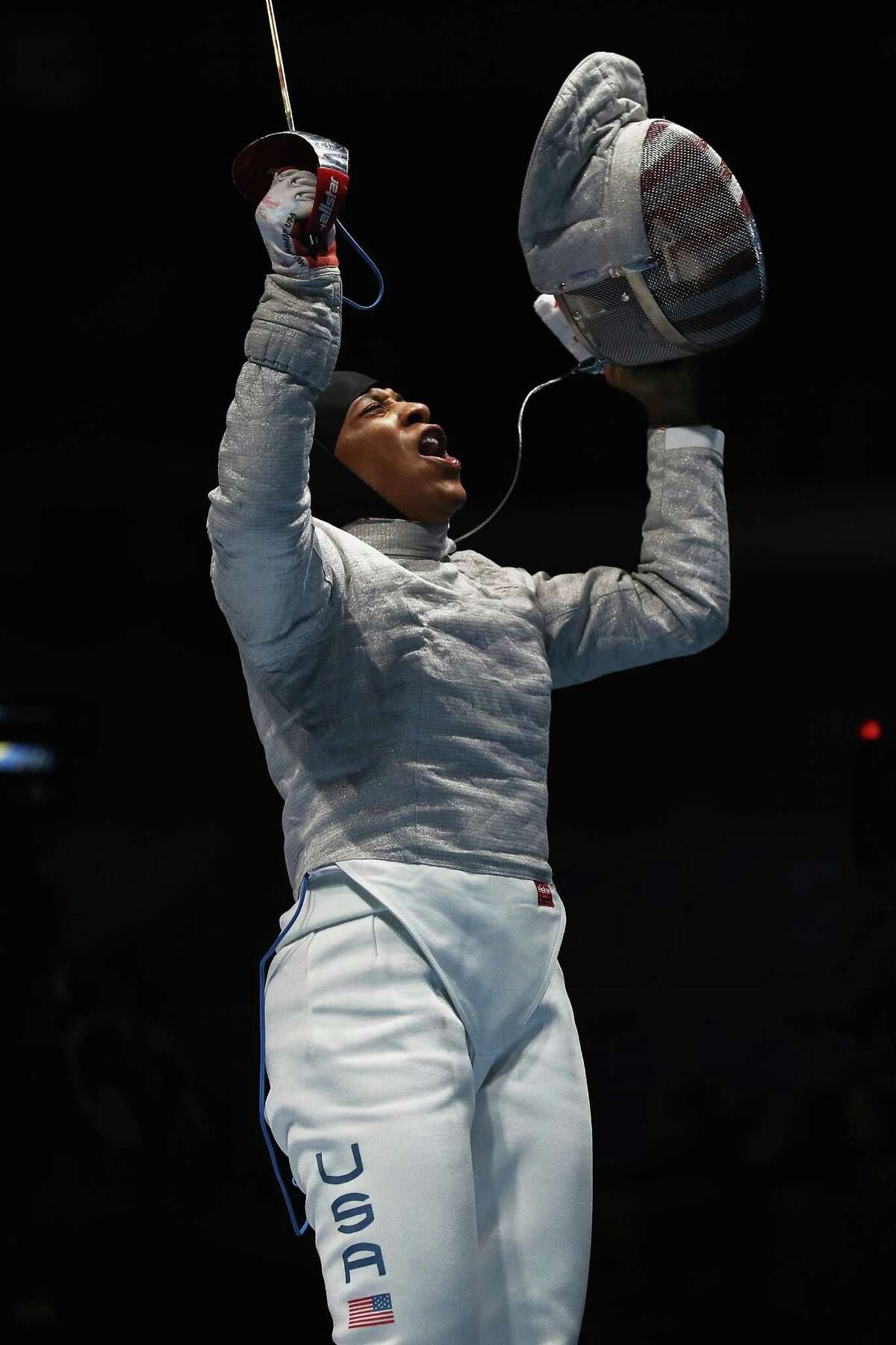 RIO DE JANEIRO, BRAZIL - AUGUST 08: Ibtihaj Muhammad of the United States celebrates victory over Olena Kravatska of Ukraine during the Women's Individual Sabre on Day 3 of the Rio 2016 Olympic Games at Carioca Arena 3 on August 8, 2016 in Rio de Janeiro, Brazil.
