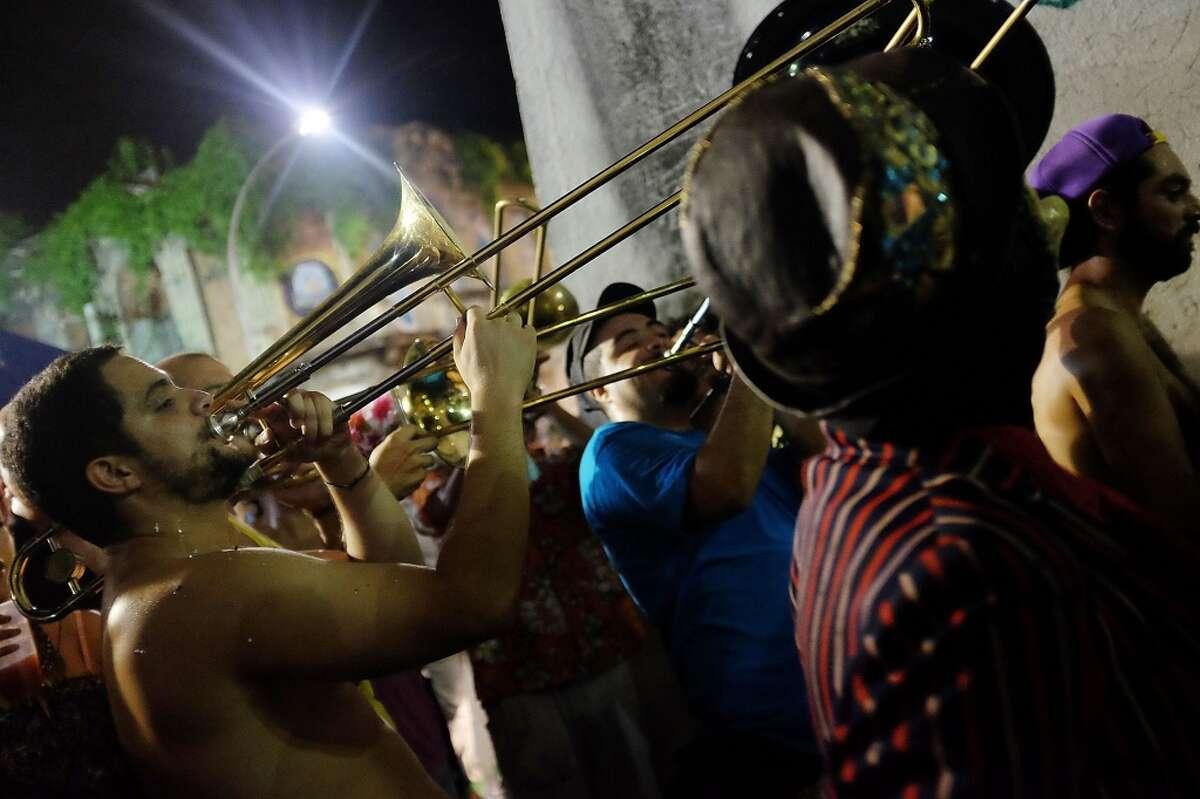 Revelers celebrate during pre-Carnival festivities on February 21, 2014 in Rio de Janeiro, Brazil.