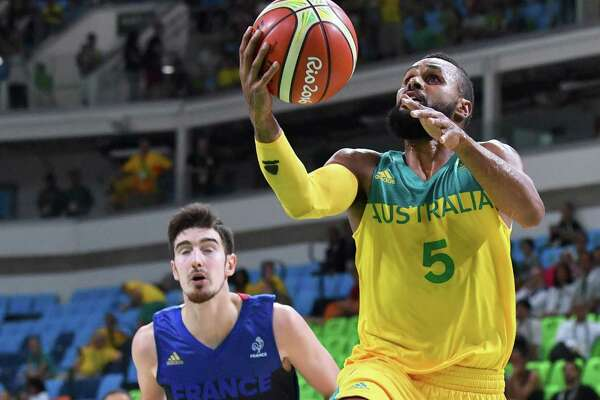 Australia's guard Patty Mills goes to the basket during a Men's round Group A basketball match between Australia and France at the Carioca Arena 1 in Rio de Janeiro on August 6, 2016 during the Rio 2016 Olympic Games. / AFP PHOTO / Andrej ISAKOVICANDREJ ISAKOVIC/AFP/Getty Images