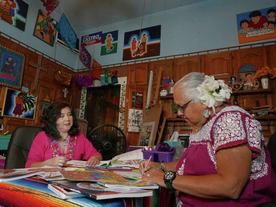 Enedina Vasquez (right) and Jennifer Marie color in faith-themed coloring books. Vasquez, whose home is filled with art and remembrances of her husband, says coloring can make us better listeners. Photo: Billy Calzada / San Antonio Express-News / San Antonio Express-News