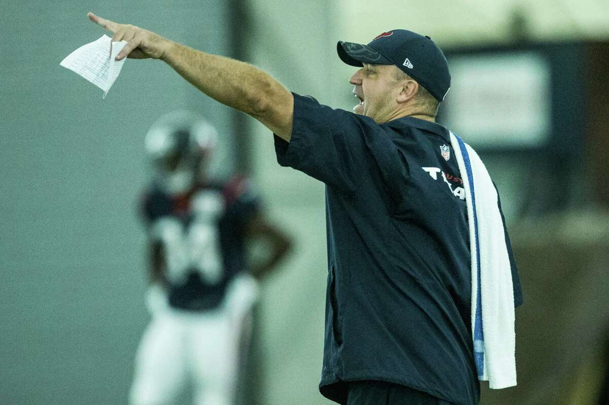 Houston Texans head coach Bill O'Brien makes a call on the field during Texans training camp at Houston Methodist Training Center on Monday, Aug. 8, 2016, in Houston.