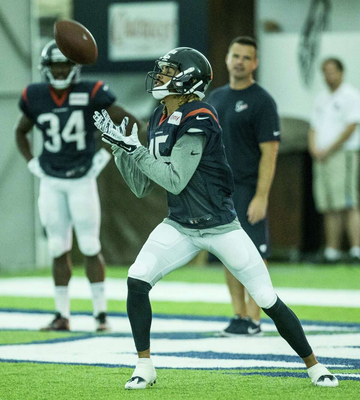 Houston Texans wide receiver Will Fuller receives a kick during Texans training camp at Houston Methodist Training Center on Monday, Aug. 8, 2016, in Houston.