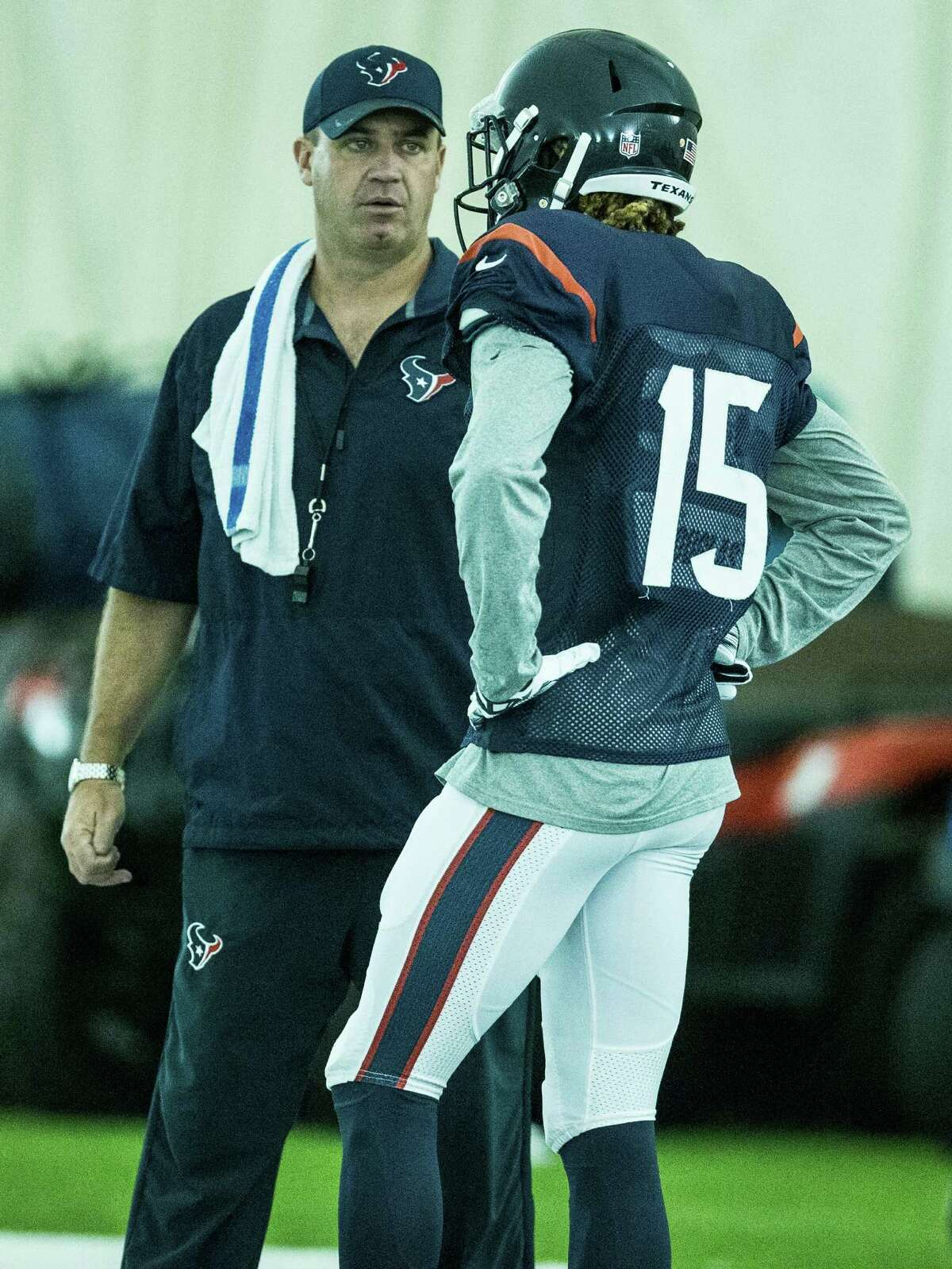 Houston Texans head coach Bill O'Brien, left, talks to wide receiver Will Fuller (15) during Texans training camp at Houston Methodist Training Center on Monday, Aug. 8, 2016, in Houston.