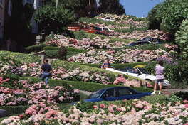 Travel, San Francisco, California, USA, Flower beds in full bloom as they follow the twists and turns of Lombard Street (Photo by Bob Thomas/Popperfoto/Getty Images)