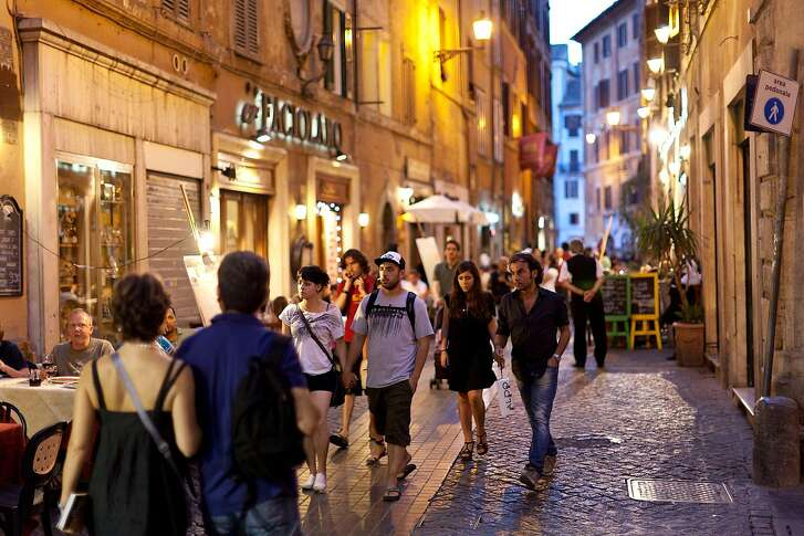 An evening stroll through city streets is an enjoyable tradition in Rome.