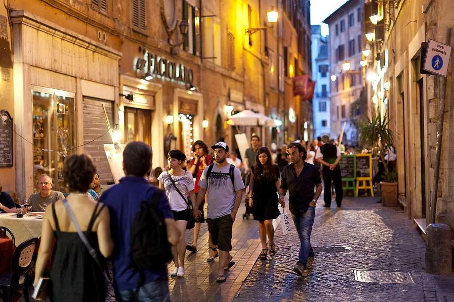 An evening stroll through city streets is an enjoyable tradition in Rome. Berlin, Paris and Madrid are also among the cities that light up after dark. Photo: Dominic Arizona Bonuccelli, Rick Steves' Europe