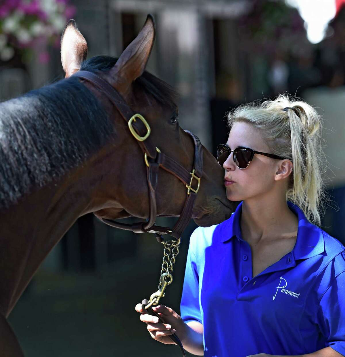 Showman Kendall Marchi 23, of Gerogetown, KY gives a smooch to Hip 159 in the Paramount Sales consignment at Fasig-Tipton in the hours before the sale this evening, Monday Aug. 8, 2016 in Saratoga Springs, N.Y. (Skip Dickstein/Times Union)