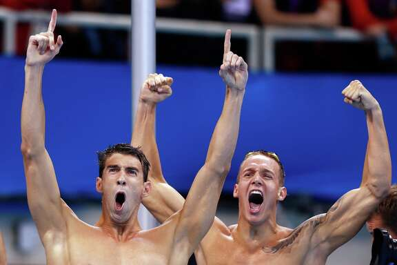 Michael Phelps and Caeleb Dressel of the United States celebrate winning gold in the Final of the Men's 4 x 100m Freestyle Relay on Day 2 of the Rio 2016 Olympic Games at the Olympic Aquatics Stadium on August 7, 2016 in Rio de Janeiro, Brazil.