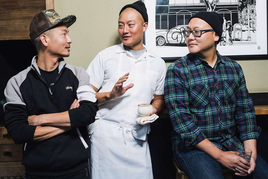 David (left), Dennis and Daniel Lee, brothers and owners of Mission's Namu Gaji, in their restaurant in S.F.  Photo: Stephen Lam, Special To The Chronicle