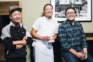 From left, David, Dennis and Daniel Lee, brothers and owners of Mission's Namu Gaji, stand together for a portrait at their restaurant in San Francisco, Calif. on Wednesday, Aug. 3, 2016.