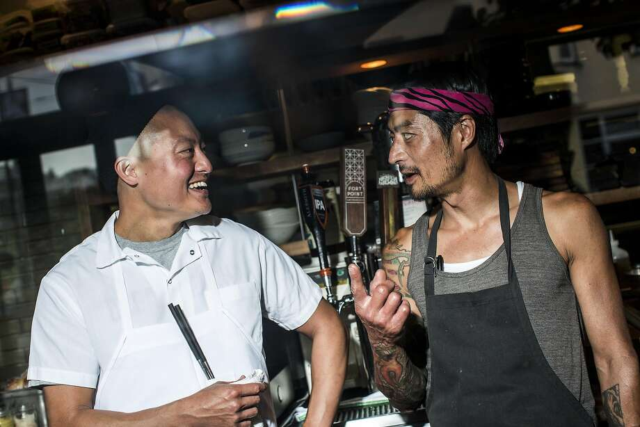 Chef Dennis Lee, left, shares a laugh with friend and Pink Zebra chef Jesse Koide during dinner service. Photo: Stephen Lam, Special To The Chronicle