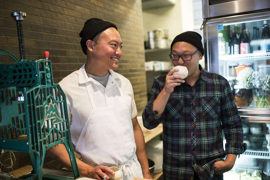 Chef Dennis Lee, left, shares a laugh with brother Daniel during dinner service. Photo: Stephen Lam, Special To The Chronicle