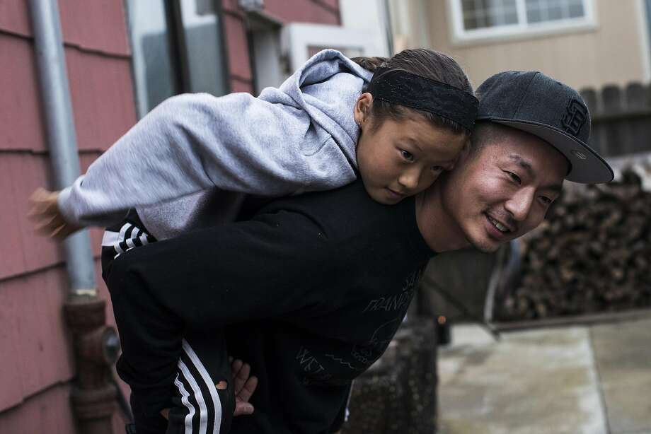 David Lee, general manager of Mission's Namu Gaji, gives a piggy back ride to niece Milla, 9, at their home in San Francisco, Calif. on Thursday, Aug. 4, 2016. Photo: Stephen Lam, Special To The Chronicle
