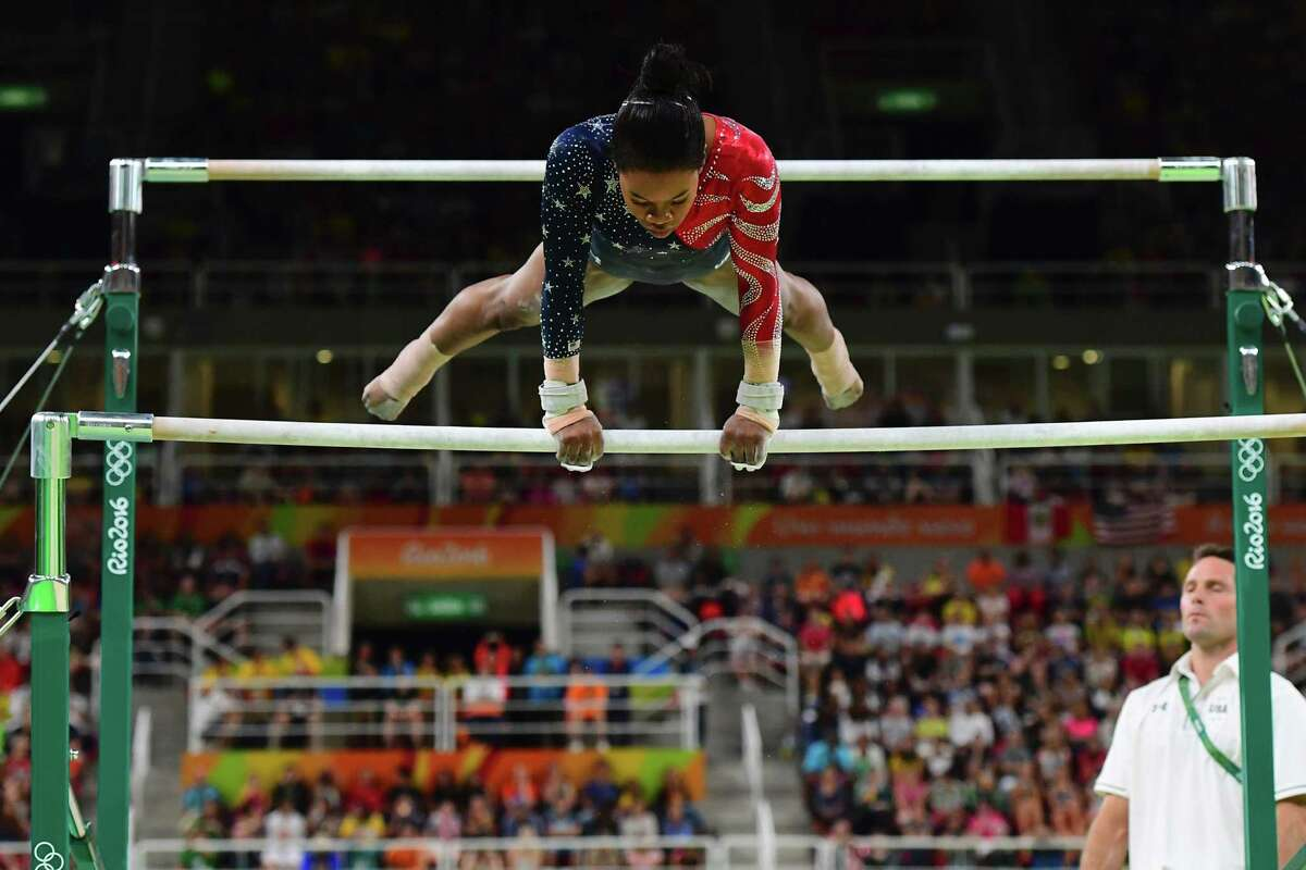 US gymnast Gabrielle Douglas competes in the qualifying for the women's Uneven Bars event of the Artistic Gymnastics at the Olympic Arena during the Rio 2016 Olympic Games in Rio de Janeiro on August 7, 2016. / AFP PHOTO / EMMANUEL DUNANDEMMANUEL DUNAND/AFP/Getty Images