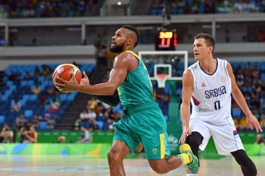 Australia's guard Patty Mills (L) evades Serbia's guard Nemanja Nedovic during a Men's round Group A basketball match between Serbia and Australia at the Carioca Arena 1 in Rio de Janeiro on August 8, 2016 during the Rio 2016 Olympic Games. / AFP PHOTO / Andrej ISAKOVICANDREJ ISAKOVIC/AFP/Getty Images Photo: ANDREJ ISAKOVIC/AFP/Getty Images