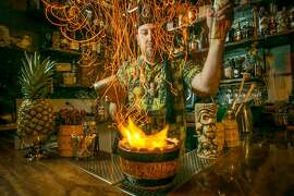 Bartender Martin Cate makes the Top Notch Volcano Punch at Smuggler's Cove in San Francisco, Calif., on Friday, October 4th, 2013.