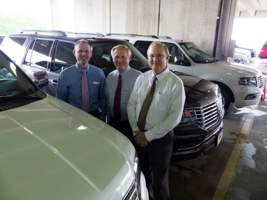 A partnership controlled by the auto group President Clarence Kahlig (center), shown with Kahlig Auto Group Chief Financial Officer Jeff Kahlig (left) and controller David Hoyer, has bought 6.7 acres of land next to its cluster of dealerships near North Star Mall. Photo: San Antonio Express-News /File Photo / San Antonio Express-News