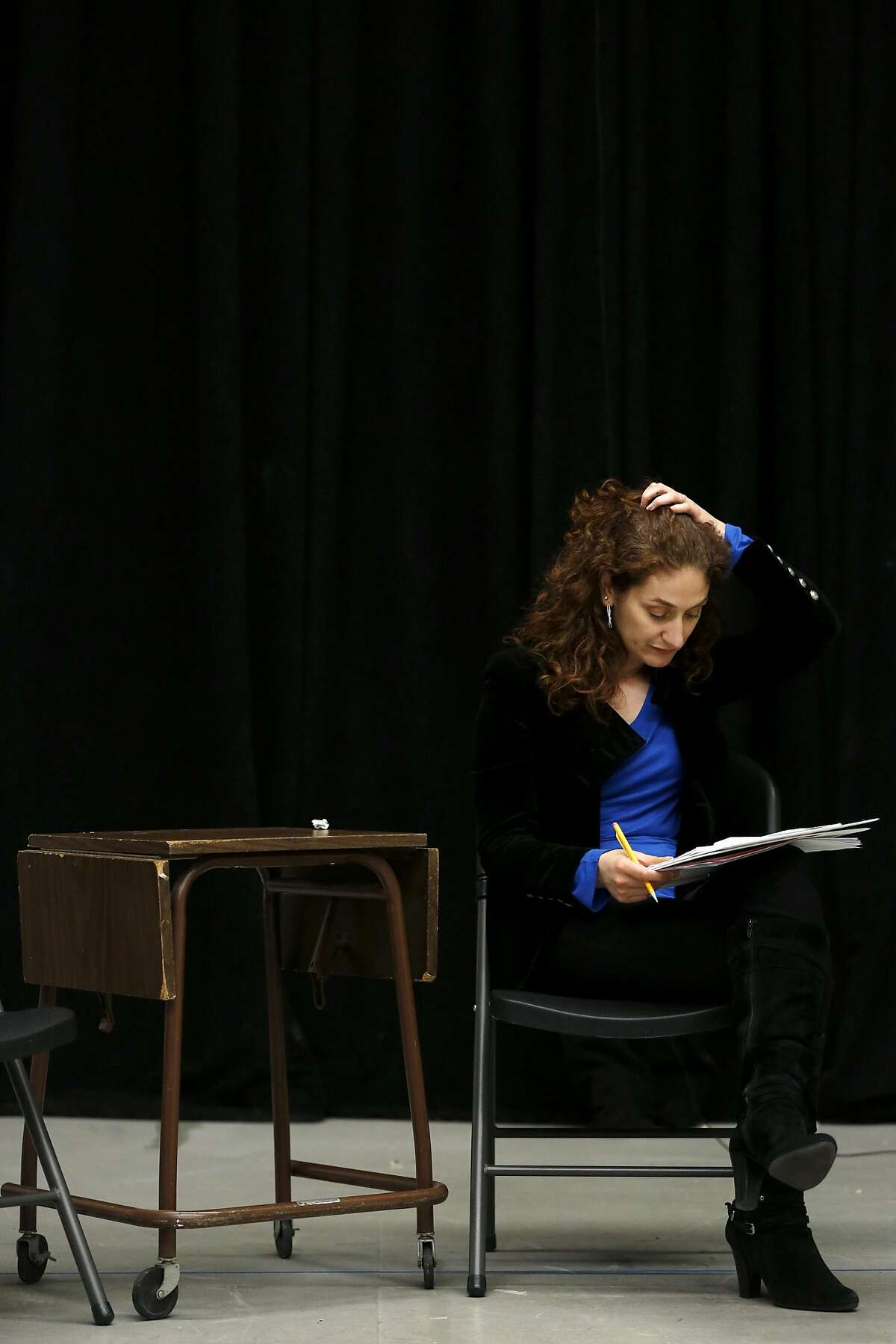 Maria Grazia Affinito reads lines during a rehearsal of