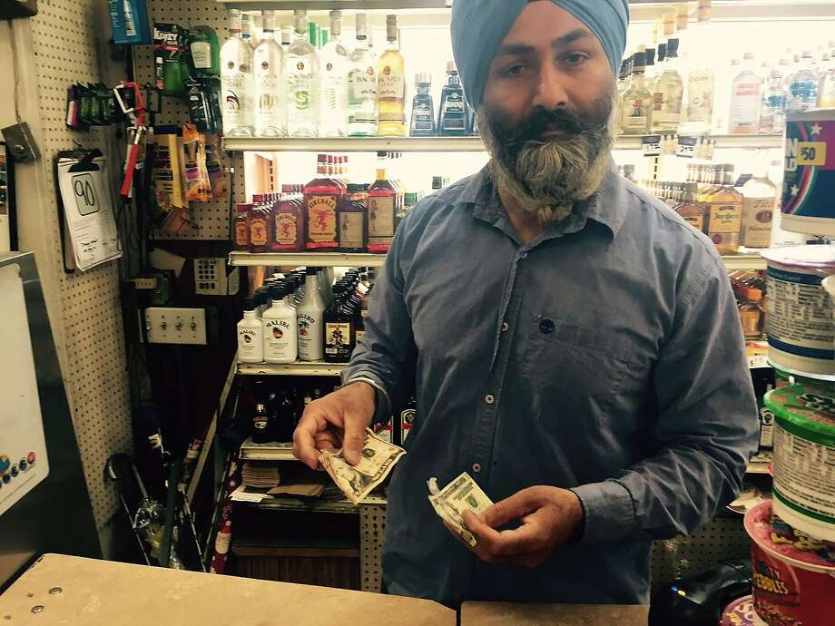 Satwinder (Bill) Maltani says he's seen an increase in counterfeit $10 and $20 bills at his Tenderloin deli and grocery story. Photo: C.W. Nevius
