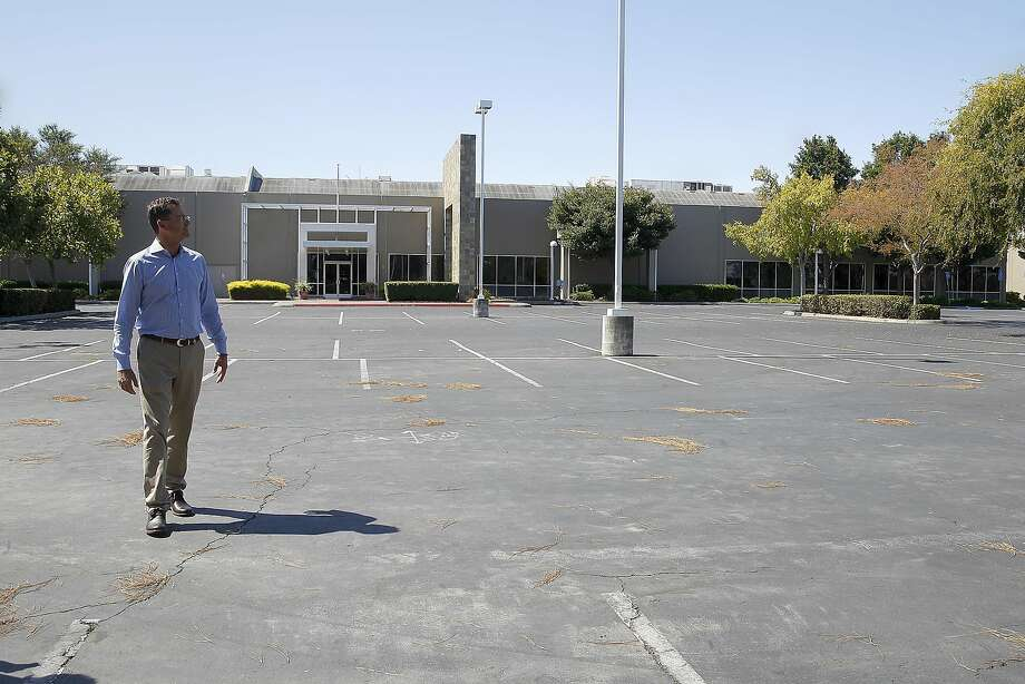 Steve Elliott, Stanford managing director of development, checks out the site of the planned development, a 35-acre site in Redwood City, former offices of ExciteAtHome. Photo: Liz Hafalia, The Chronicle
