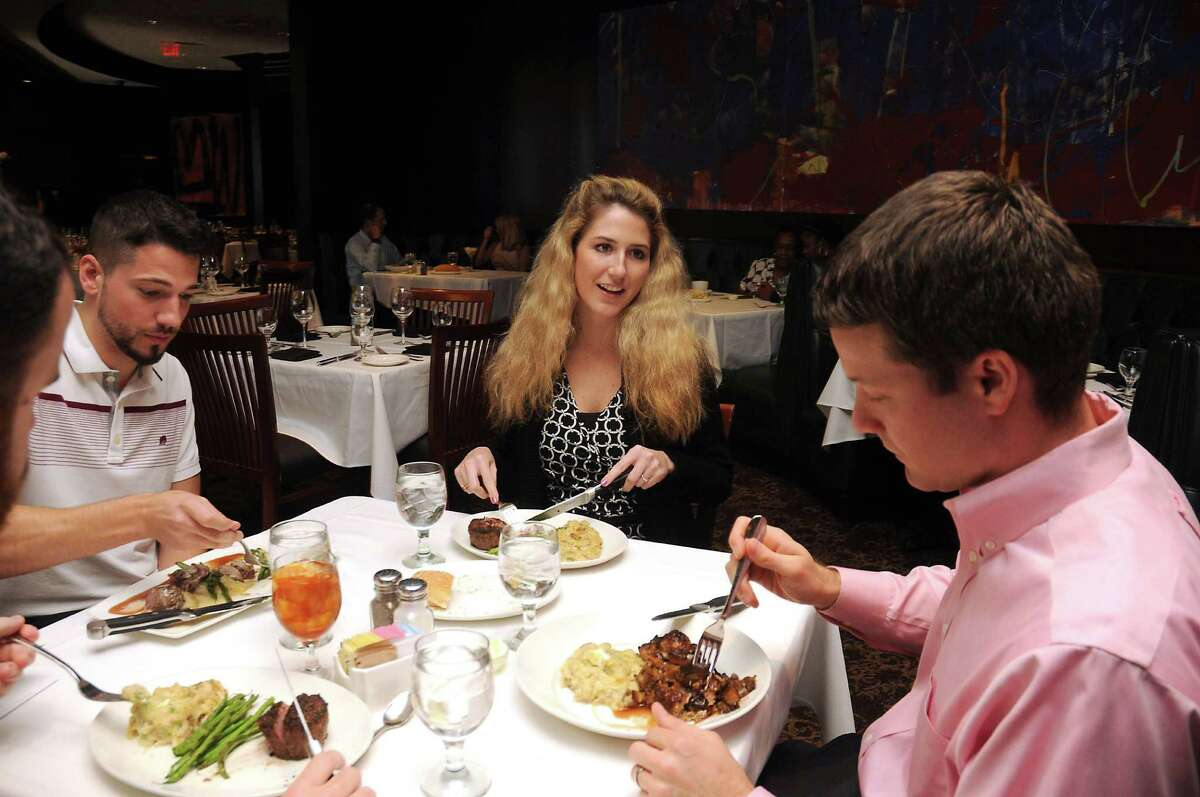 From left: Rob Mercier, Lauren Nicholas and Brian Legg enjoy their meal at Del Frisco's Double Eagle Steak House Wednesday Aug. 03,2016.(Dave Rossman Photo)