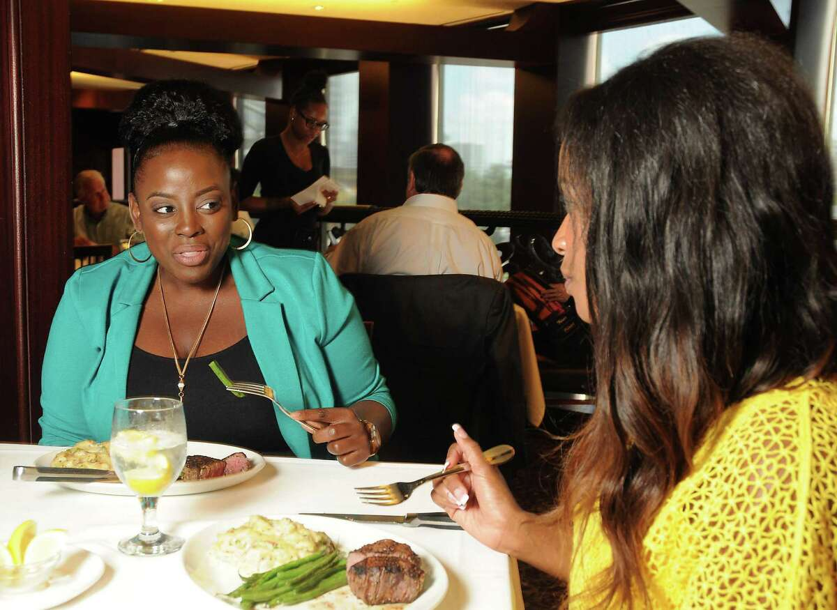 Destiny Warfield and Carrie Sampson enjoy their fillets during restaurant week at Del Frisco's Double Eagle Steak House Wednesday Aug. 03,2016.(Dave Rossman Photo)