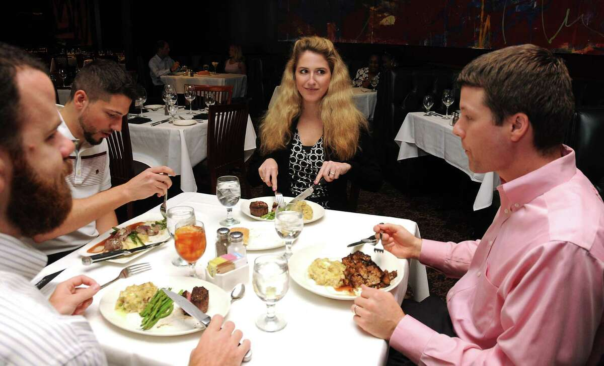 From left: Caleb Bauer, Rob Mercier, Lauren Nicholas and Brian Legg enjoy their meal at Del Frisco's Double Eagle Steak House Wednesday Aug. 03,2016.(Dave Rossman Photo)