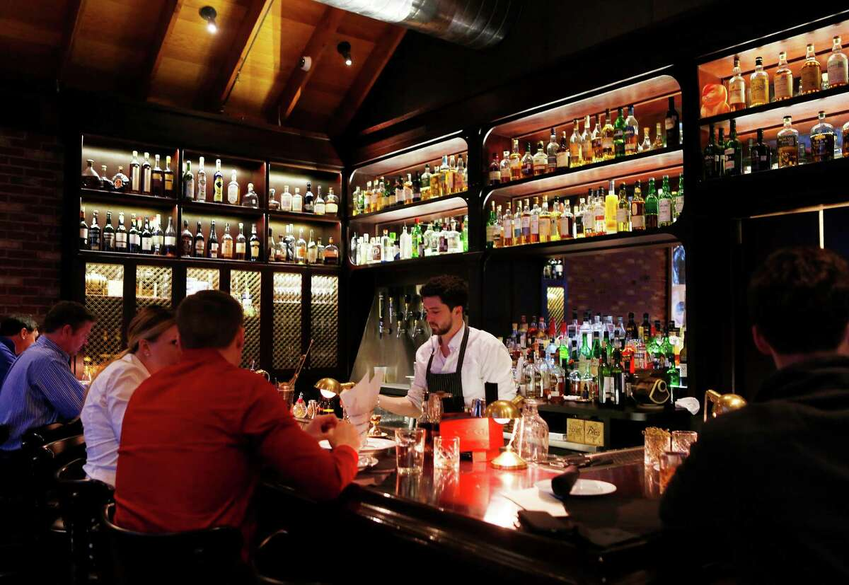 Patrons pack the bar at Hunky Dory. The owners of Hunky Dory and its sister restaurant Bernadine's announced the restaurants will close May 24.