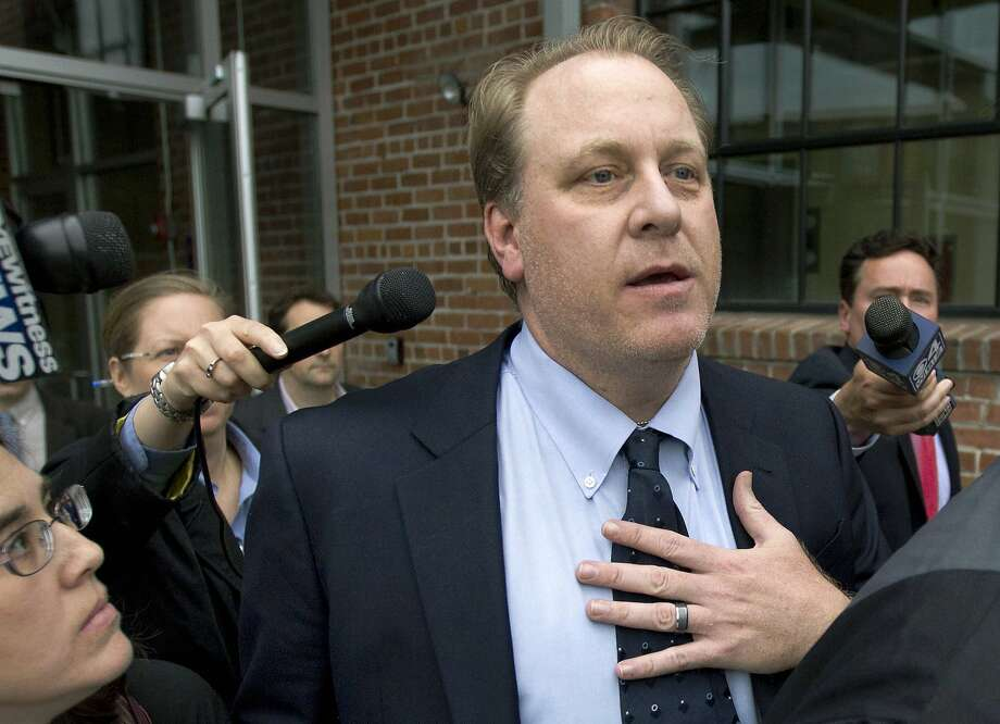 FILE - In this Wednesday, May 16, 2012, file photo, former Boston Red Sox pitcher Curt Schilling, center, is followed by members of the media as he departs the Rhode Island Economic Development Corporation headquarters, in Providence, R.I. An investigation into Schilling's failed video game company, 38 Studios, has resulted in no criminal violations, authorities announced Friday, July 29, 2016. (AP Photo/Steven Senne, File) Photo: Steven Senne, Associated Press