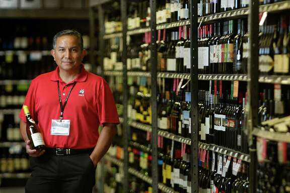 Ralph Castellano, senior wine consultant at Spec's, recommends a Château de Santenay chardonnay, found among the huge wine section at the Midtown store.