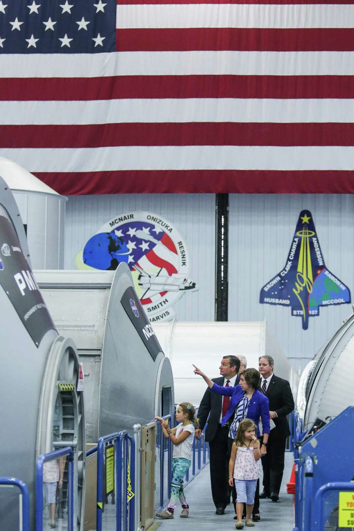 Johnson Space Center Director Dr. Ellen Ochoa gives Sen. Ted Cruz and his daughters a tour of a mockup of the International Space Station Monday, August 8, 2016 in Houston.