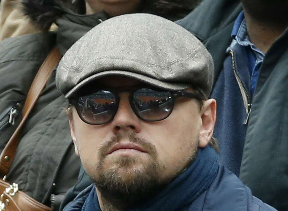 In this June 3, 2016 file photo, U.S. actor Leonardo DiCaprio watches Britain's Andy Murray play his semifinal match of the French Open tennis tournament against Switzerland's Stan Wawrinka at the Roland Garros stadium in Paris, France. U.S. Olympic archer Brady Ellison has been getting plenty of comparisons to DiCaprio, mostly because some see facial resemblances. (AP Photo/Alastair Grant) Photo: Alastair Grant, Associated Press