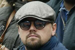 FILE - In this June 3, 2016 file photo, U.S. actor Leonardo DiCaprio watches Britain's Andy Murray play his semifinal match of the French Open tennis tournament against Switzerland's Stan Wawrinka at the Roland Garros stadium in Paris, France. U.S. Olympic archer Brady Ellison has been getting plenty of comparisons to DiCaprio, mostly because some see facial resemblances. (AP Photo/Alastair Grant)