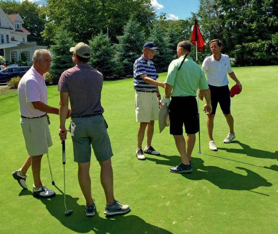 Handshakes on the 36th hole after Tim Romano defeated Cody Schwarz for the Longshore Mens Golf Association Club Championship title on Sunday. Photo: Contributed Photo / Westport News Contributed