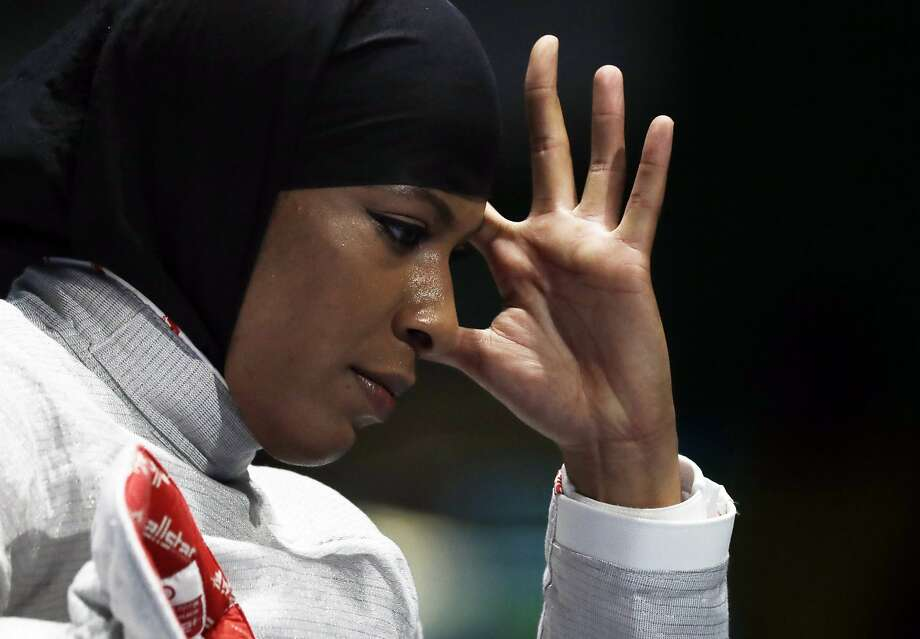 Ibtihaj Muhammad of the United States reacts after losing against Cecilia Berder of France in the women's individual saber fencing event at the 2016 Summer Olympics in Rio de Janeiro, Brazil, Monday, Aug. 8, 2016. (AP Photo/Andrew Medichini) Photo: Andrew Medichini, Associated Press