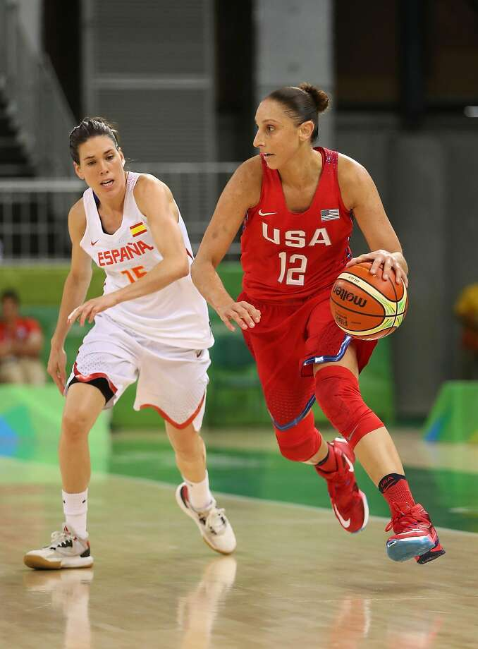 Diana Taurasi, who scored 13 points, dribbles past Spain's Anna Cruz during the United States' 103-63 victory. Photo: Christian Petersen, Getty Images