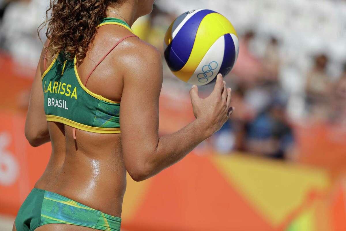 Brazils' Larissa Franca serves to Russia during a women's beach volleyball match at the 2016 Summer Olympics in Rio de Janeiro, Brazil, Sunday, Aug. 7, 2016. (AP Photo/Marcio Jose Sanchez)
