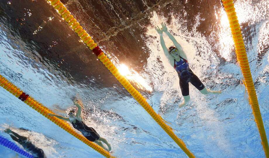 Lilly King (right) and Katie Meili compete in a semifinal of the women's 100-meter breaststroke Sunday. Photo: David J. Phillip, Associated Press