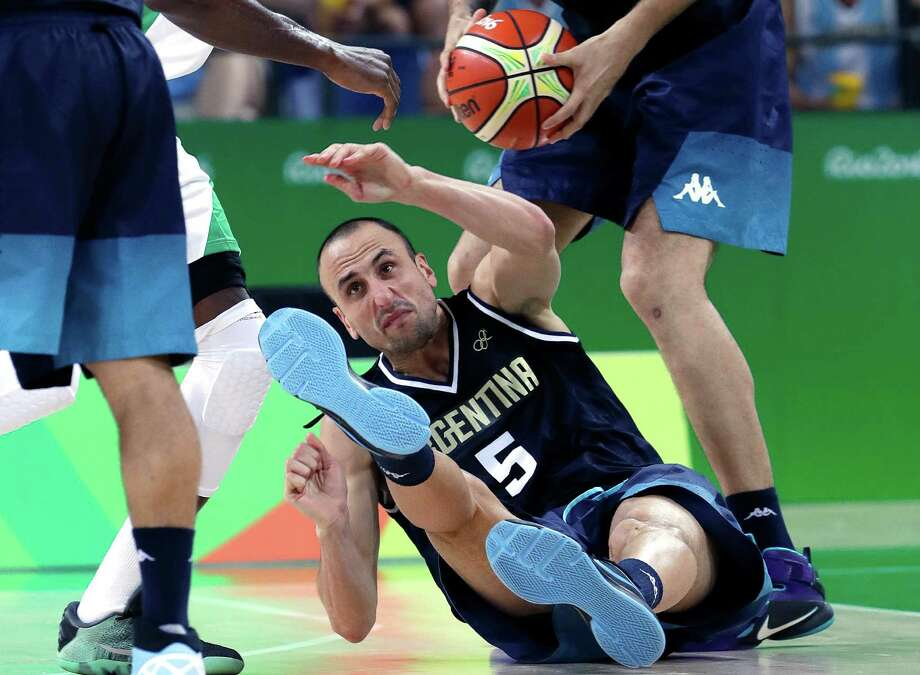 Argentina's Manu Ginobili falls to the floor as he chases a loose ball during a men's basketball game against Nigeria at the 2016 Summer Olympics in Rio de Janeiro on Aug. 8, 2016. Photo: Eric Gay /Associated Press / Copyright 2016 The Associated Press. All rights reserved. This material may not be published, broadcast, rewritten or redistribu