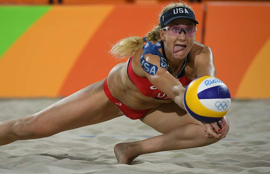 USA's Kerri Walsh Jennings dives for the ball during the women's beach volleyball qualifying match between the USA and Australia at the Beach Volley Arena in Rio de Janeiro on August 7, 2016, for the Rio 2016 Olympic Games. / AFP PHOTO / Yasuyoshi ChibaYASUYOSHI CHIBA/AFP/Getty Images Photo: YASUYOSHI CHIBA, AFP/Getty Images
