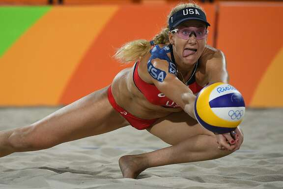 USA's Kerri Walsh Jennings dives for the ball during the women's beach volleyball qualifying match between the USA and Australia at the Beach Volley Arena in Rio de Janeiro on August 7, 2016, for the Rio 2016 Olympic Games. / AFP PHOTO / Yasuyoshi ChibaYASUYOSHI CHIBA/AFP/Getty Images