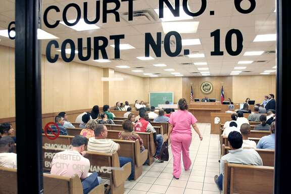"""Houston Municipal Courts, 1400 Lubbock. Generic """"crowd"""" shots for story on Fulbright and Jaworski lawyers volunteering their time as prosecutors to help clear dockets. (Crowds were quite light today--I understand it was a lot busier Tuesday--chh) Basement of building--according to signage, court 6 is for day use and court 10 is for night use. Thursday 08/31/06. (Craig H. Hartley/For the Chronicle)"""